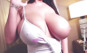 Leanne Crow sliding her tits in and out of thin vest