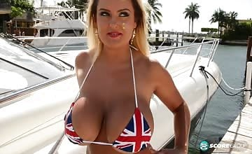 Katie Thornton strips out of British flag bikini to reveal huge tits and wet pussy