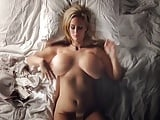 Blonde with massive tits plays solo