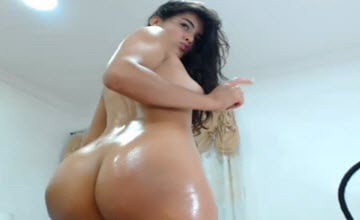 The most sexy busty Latina cam girl fully oiled