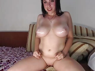 Oiling my perky white tits and bald pussy on webcam