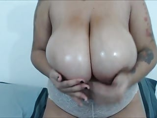 Mixed race BBW cam girl oils her giant titties up