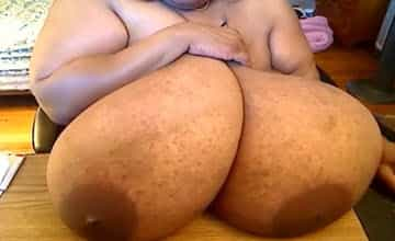 Norma Stitz sucks on her record breaking black tits