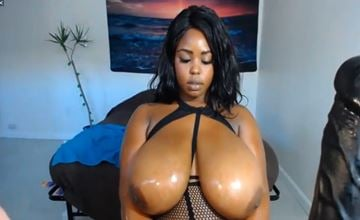 Sexy black chick oiled big tits on webcam